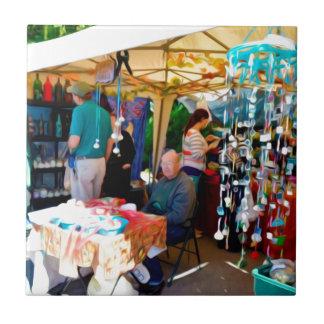 Handwerks-Verkäufer am Knoblauch-Festival Keramikfliese