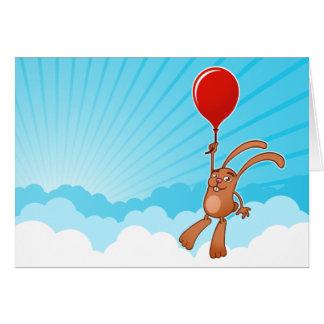 Häschen mit Ballon in der Grußkarte des blauen Him