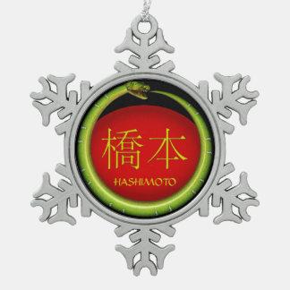 Hashimoto-Monogramm-Schlange Schneeflocken Zinn-Ornament