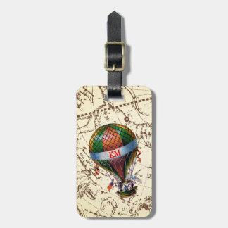 Heißluft-Ballon schwimmt auf Tierkreis-Himmel Gepäckanhänger