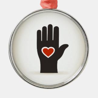 Herz in einer Hand Silbernes Ornament