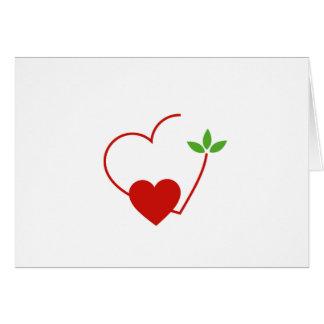Herzen mit dem Blätter erfasst in einem Platz Karte