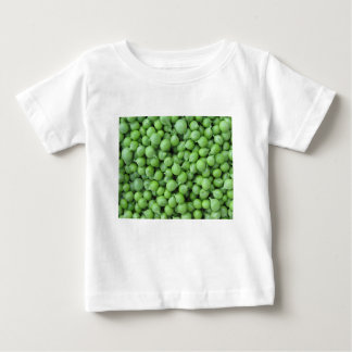 Hintergrund der grünen Erbse. Beschaffenheit der Baby T-shirt