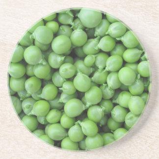 Hintergrund der grünen Erbse. Beschaffenheit der Sandstein Untersetzer