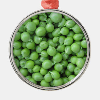 Hintergrund der grünen Erbse. Beschaffenheit der Silbernes Ornament