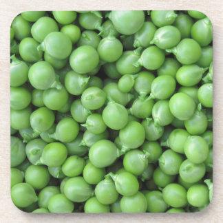 Hintergrund der grünen Erbse. Beschaffenheit der Untersetzer