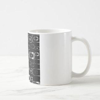 Hintergrund mit metallischen Formen Kaffeetasse