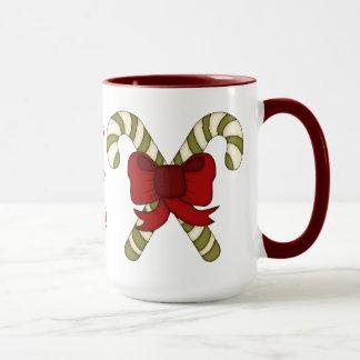 HO HO HO! Zuckerstangen gebunden mit einem roten Tasse