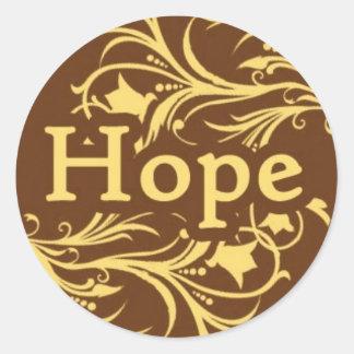 Hoffnung auf einem Gelb und Wirblen einem Muster Runder Aufkleber