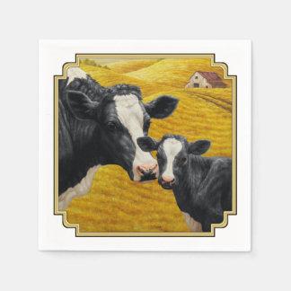 Holstein-Kühe und alte hölzerne Scheune Servietten