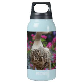 Hölzerne Ente mit Blumen Isolierte Flasche