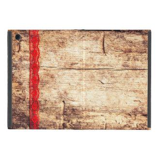 Hölzerner Beschaffenheits-Hintergrund. Rotes Band. Schutzhülle Fürs iPad Mini
