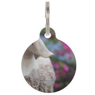 Hölzerner Entenkopf mit Blumen Tiernamensmarke