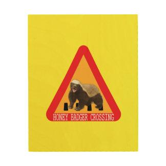 Honig-Dachs-Überfahrt-Zeichen - gelber Hintergrund Holzleinwände
