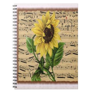 Hübsche Sonnenblume auf Musik Notizblock