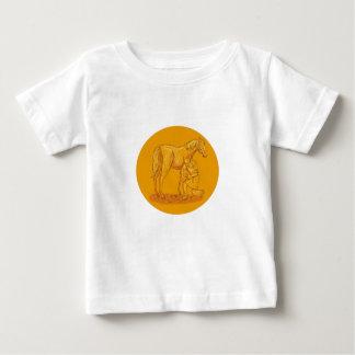 Hufschmied, der Schuh auf dem Baby T-shirt