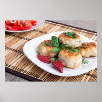 Huhnfleischklöschen des gehackten Fleisches und Poster
