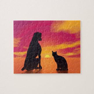 Hunde- und Katzenfreundschaft am Sonnenuntergang Puzzle