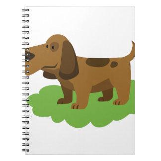 Hundeniedlicher Cartoonentwurf Spiral Notizblock