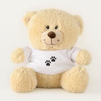 Hundetatzen auf Weiß Teddybär