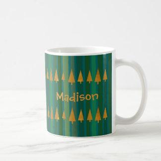 Imitat-Goldfolien-Weihnachtsbäume mit grünen Kaffeetasse
