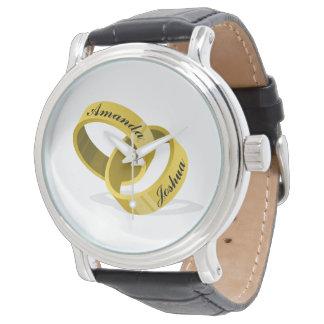 Ineinander greifenhochzeits-Ringe - gravierte Armbanduhr