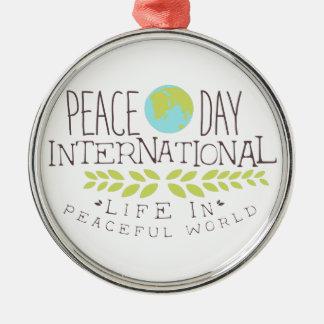Internationale Friedenstagesaufkleber-Entwürfe Silbernes Ornament