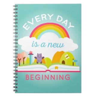 Ist ein niedlicher Regenbogen des neuen Anfanges Notizblock