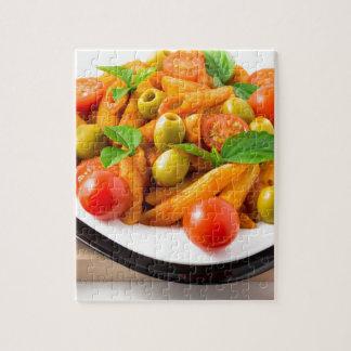 Italienisches Teigwaren penne in der Tomatensauce Puzzle