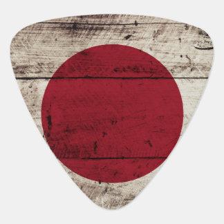 Japan-Flagge auf altem hölzernem Korn Plektron