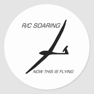 JETZT FLIEGT DIESES… schwarzes Segelflugzeug Runde Aufkleber