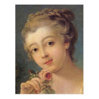 Junge Frau mit einem Blumenstrauß der Rosen im Postkarte