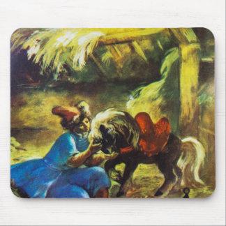 Junge und ein Pony in einer Halle mit Heu Mousepad