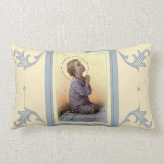 Jungen-Kind Jesus, der auf seinem Bett betet Lendenkissen