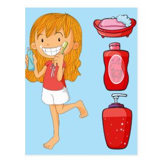 Jungen und bürstende Zähne des Mädchens Postkarte