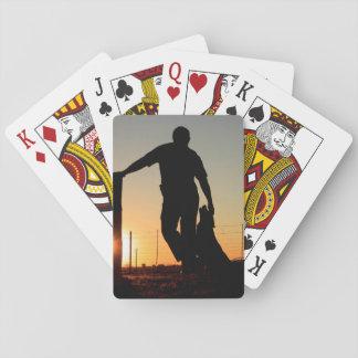Junger Bauer/Cowboy und seine HundeSilhouette Spielkarten