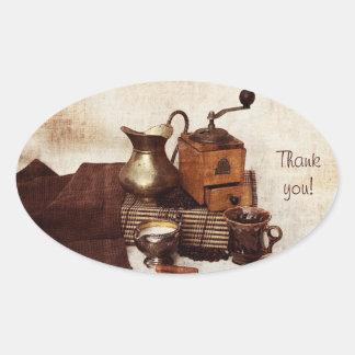 Kaffeebohnen und alte Kaffeemühle danken Ihnen Ovaler Aufkleber