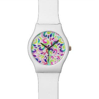 Karnevals-Farbexplosion der hellen Extravaganz Uhr