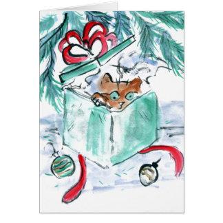 Kätzchen in zerrissenem Weihnachtsgeschenk-Kasten Karte