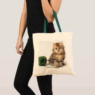 Kätzchen mit grünem Garn Tragetasche