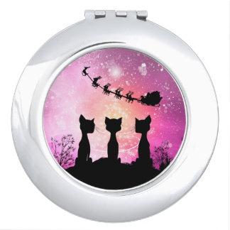 Katzen schaut zum Himmel zu Weihnachtsmann Taschenspiegel