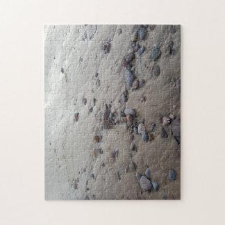 Kiesel auf dem Sand-Foto-Puzzlespiel Puzzle