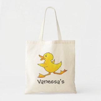Kinderniedliche gelbe Entenbibliothek oder Tragetasche