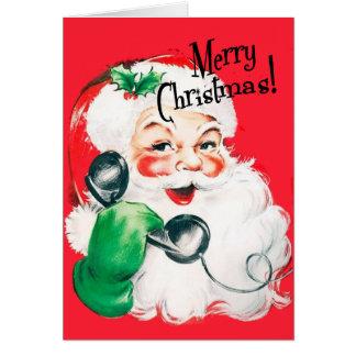 Kitschy Weihnachtsmann auf den Telefon-frohen Grußkarte