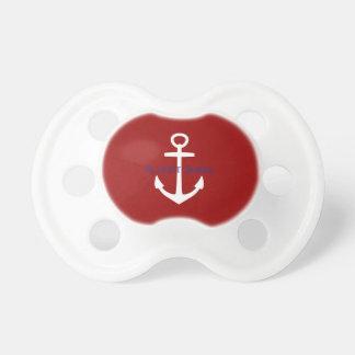 Klassischer weißer Anker auf rotem Schnuller