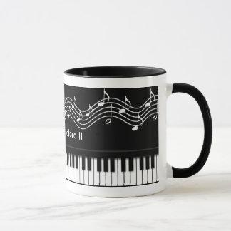 Klavier-Tastatur und Anmerkungs-Tasse Tasse