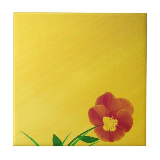 kleine blüte auf goldenem untergrund fliese