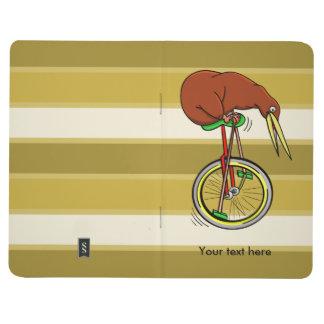 Kleine Brown-Kiwi auf einem roten Unicycle Taschennotizbuch