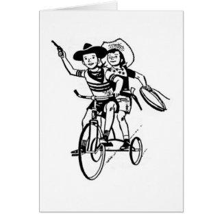 Kleine Cowpokes auf einem Dreirad Karte