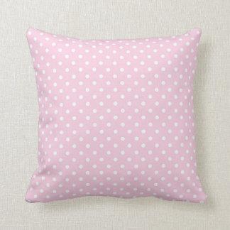 Kleine weiße Punkte im rosa Kissen